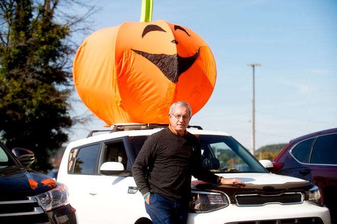 David Weech poses for a photo with his Halloween-themed Kia Soul during a visit to the Knoxville News Sentinel on Oct. 30, 2018.