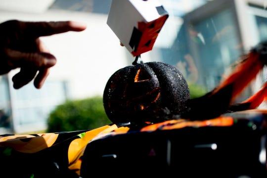 A pumpkin sits on the dashboard of David Weech's Halloween-themed Kia Soul.