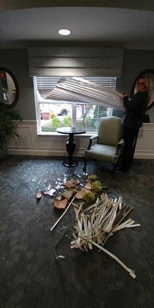 Kelly Haddock, executive director of Independence Village Retirement Community in Brighton, shows where a deer entered the building on Oct. 30, 2018.