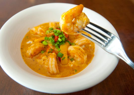 Sway Restaurant Chef Richard Doering's shrimp and grits are made with shrimp sautŽed with peppers, onions and tomatoes in a cajun seasoning cream and white wine sauce served over Weisenberger stoneground grits and garnished with green onions.October 18, 2018
