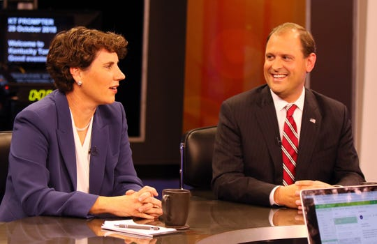 Amy McGrath, left, and Andy Barr talk before the start of the 6th Congressional Debate at KET in Lexington, Oct. 29, 2018.