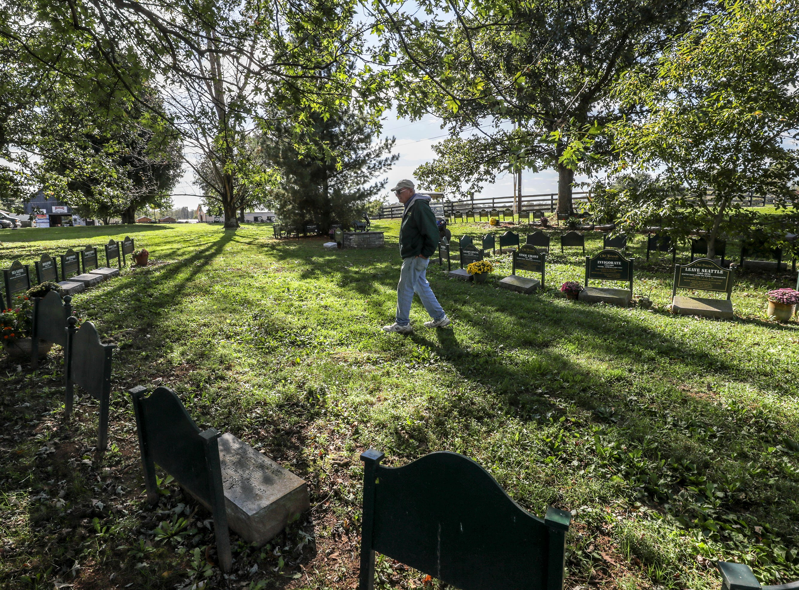 Old Friends Farm founder Michael Blowen walks thru the cemetery at the farm in Georgetown where many Breeders Cup champions are buried.October 10, 2018