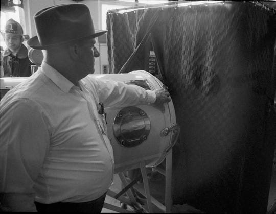 Bill Ashley, who was confined to an iron lung, voted at Stonestreet Elementary School in Valley Station. Two Jefferson county election officials went into the voting booth to pull the levers for him.  By Charles Fentress Jr., The Courier-Journal. Nov. 5, 1968