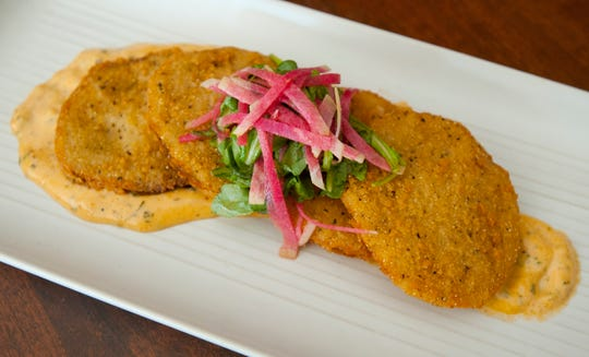 Sway Restaurant Chef Richard Doering's fried green tomatoes are served atop a spicy creole remoulade and garnished with watermelon radish and arugula.October 18, 2018