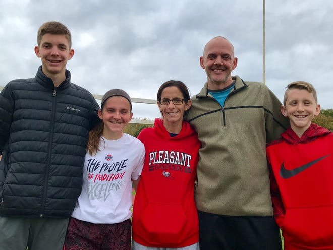 The Lichtenbergers, Caleb, Emma, Beth, Andy and Will, plan on celebrating Emma's state cross country berth this Saturday. Beth, who is also an assistant cross country coach, was diagnosed with breast cancer this summer and had surgery during the season, but was back to see her daughter earn a spot in the Division III field.