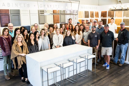 Staff members pose for a portrait at the Regency Homebuilders office. The company was voted the Top Workplace among small businesses.