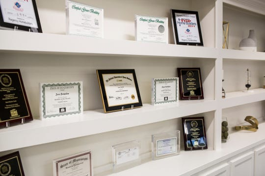 Awards and certificates are displayed at the Regency Homebuilders office in Germantown. Regency Homebuilders was voted the Top Workplace among small businesses in Memphis.