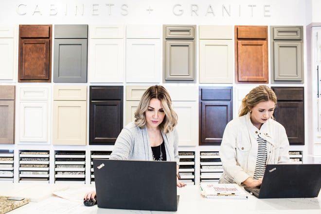 Nikki Tubbs, left, and Victoria Ricketts, designers with Regency Homebuilders, work at the Regency Homebuilders office in Germantown. Regency Homebuilders was voted the Top Workplace among small businesses.