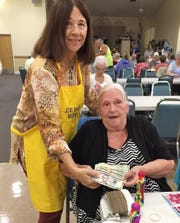Greta Mullins with with JCMI Bingo Committee member Dianne Bonfield. Mullins was the big winner at Monday Night Bingo.