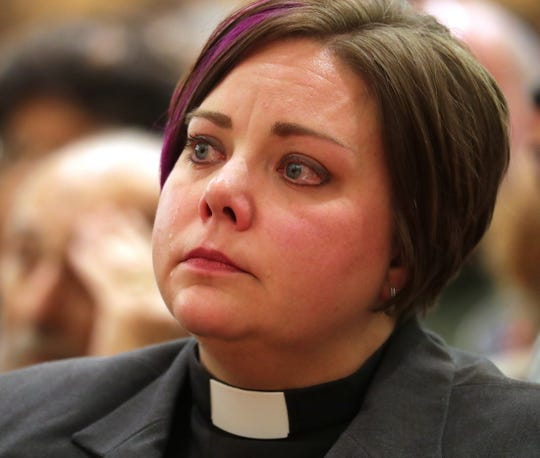The Rev. Kris Androsky of Community United Methodist Church in Elm Grove  tears up during the service.