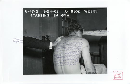 "Ruben Ramirez, an inmate from one of artist Nigel Poor's photography classes at San Quentin State Prison, writes his reflections on an old, archival photograph recently found at the prison. The original 1963 photograph documents a stabbing incident. Ramirez writes about the arms that buttress the figure, a ""once proud castle."""