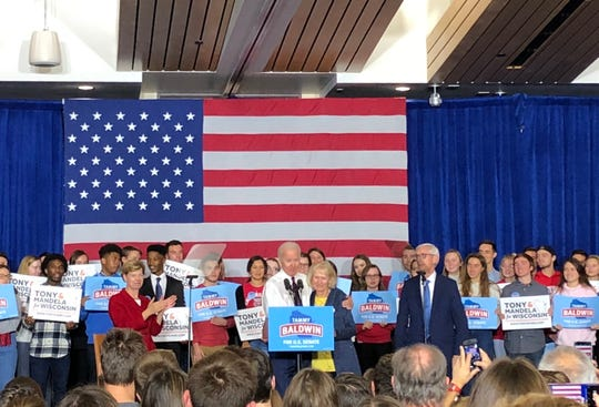 Former Vice President Joe Biden hugs Tony Evers' wife, Kathy, as he urges UW-Madison students on Tuesday to vote for her husband in the race for governor.