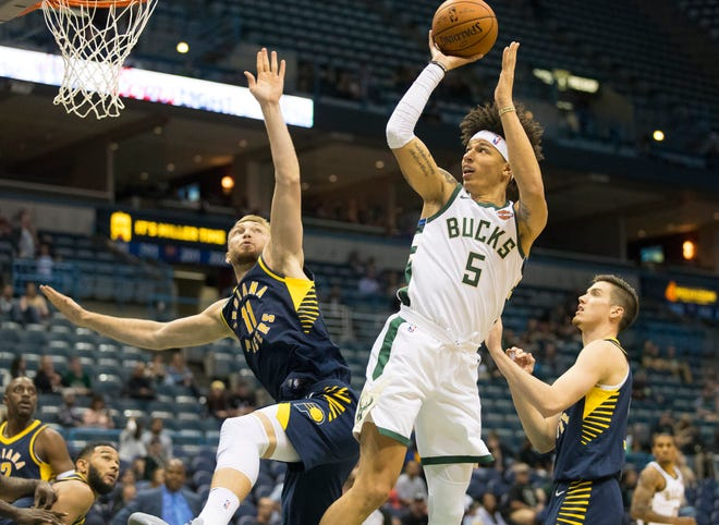 Bucks forward D.J. Wilson will be back with the team next season.