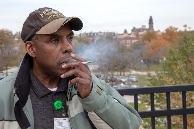 Michael Hughes, a mail clerk at the Milwaukee VA Hospital, takes a smoke break. The 64-year-old Vietnam veteran has smoked since he was 15 and is planning to quit soon — his 9th attempt — for a number of reasons, including the Milwaukee VA Hospital's new policy banning smoking for patients and employees. Starting Jan. 1, all employees will be barred from smoking during work.