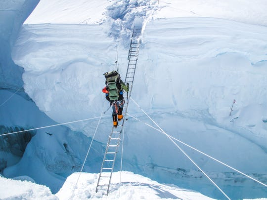 Cedarburg native Eric Larsen, who now lives in Colorado, has traveled to some of the world's most extreme places, including Mount Everest. Here he crosses a crevasse on the world's tallest mountain.