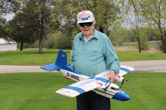Chuck Hocking shares his love of radio-controlled airplanes with fellow residents at Three Pillars in Dousman.