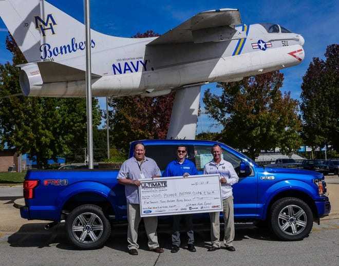 """Ultimate Auto Group recently donated $5,760 to the Mountain Home High School Athletic Department. The funds were provided through """"Ford Drive 4 UR School"""" fundraiser held at Bomber Fest in August. Pictured are: (from left) Brent Bogy, MHHS Principal; Brad Goeke, Ultimate Auto Group; and Mitch Huskey, MHHS Athletic Director."""