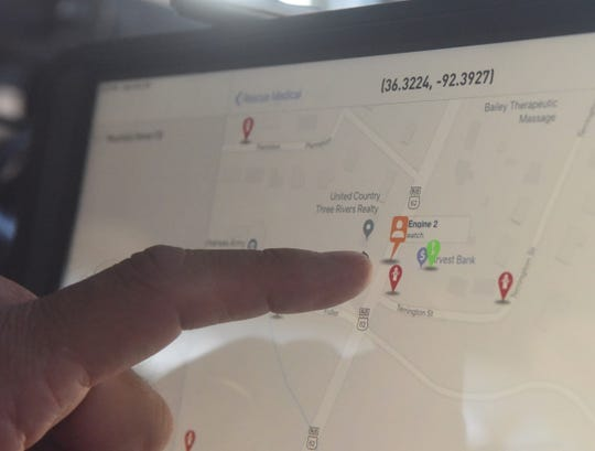 Cpt. Kris Quick of the Mountain Home Fire Department points out the location of Engine 2 in real time using the Active911 system as the truck drives through the city Monday.