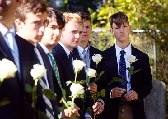 Delbarton students during a graveside service and blessing at Orchard Street Cemetery in Dover gathering to bless the grave for baby Anthony Mary, whom they so-named after he was abandoned and found deceased at a recycling center in Mine Hill. October 30, 2018, Dover, NJ