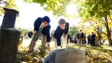 Delbarton students gather at the grave of an abandoned stillborn at Orchard Street Cemetery in Dover. The students held a funeral for the baby boy.