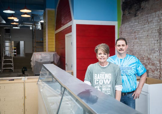 Owner Scott Mick and manager Danielle Woodson pose at the future site of the Barking Cow restaurant in downtown Muncie Tuesday afternoon.