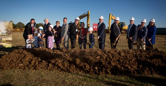 Folks pose with shovels to celebrate the groundbreaking for a future Vanderbilt children's health-care office in Murfreesboro's Gateway area.