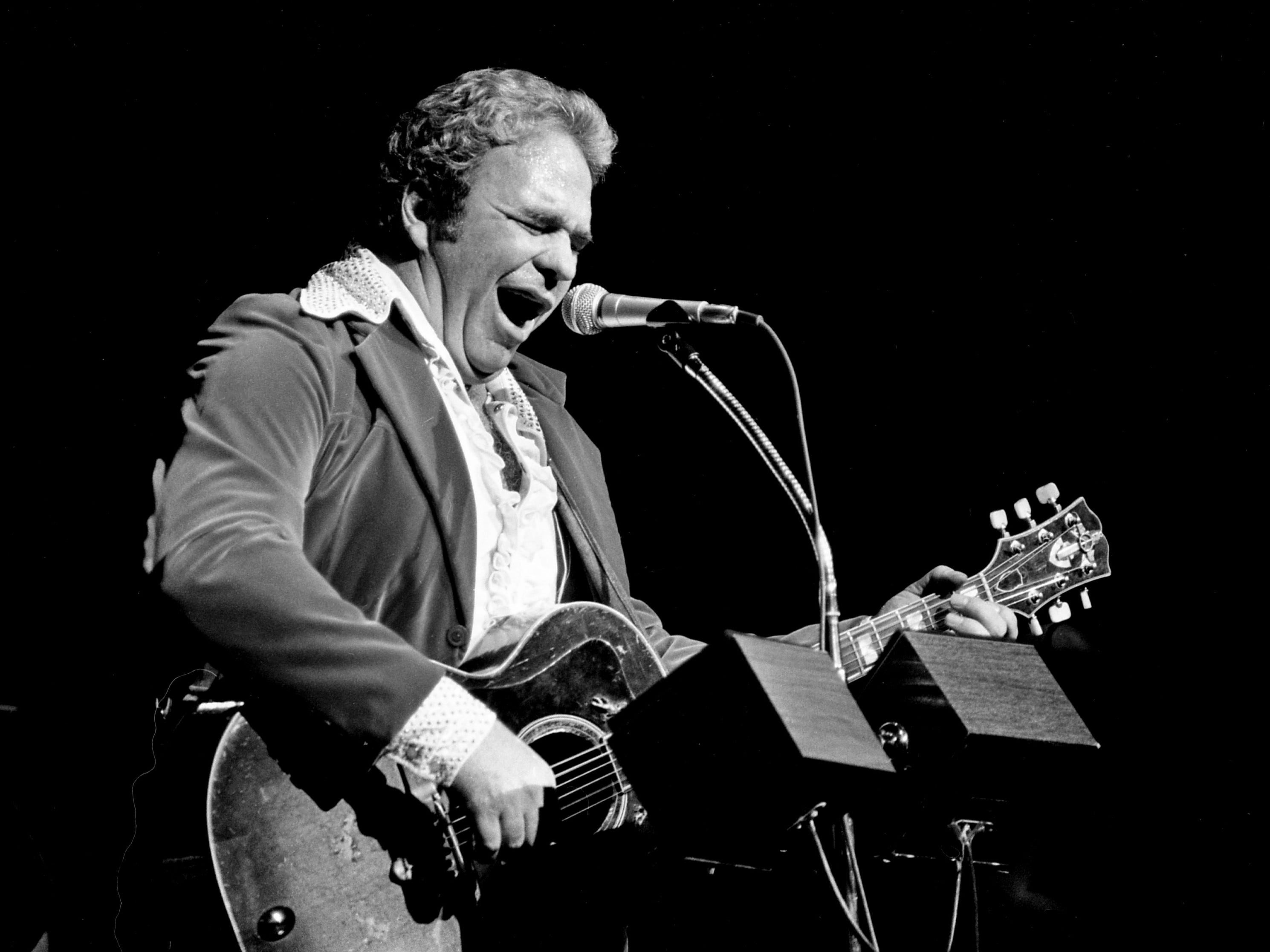 Singer-songwriter Hoyt Axton performs during his Halloween concert at the Grand Ole Opry House on Oct. 31, 1978.