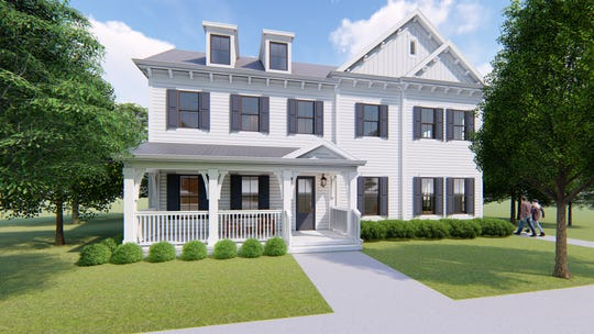 Regent Homes' condominium building in Carothers Farms resembles a farmhouse and fits into the surrounding neighborhood. It was designed by 906 Studio, Architects.