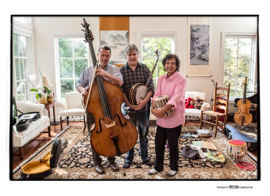 Edgar Meyer, left, Bela Fleck and Zakir Hussein rehearse together in October. The trio will perform Nov. 4 at Schermerhorn Symphony Center.