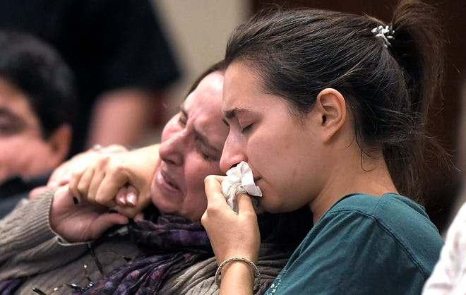 People pray during a memorial for the victims of the Tree of Life Synagogue in Pittsburgh at The Temple in Nashville on Monday, Oct. 29, 2018.