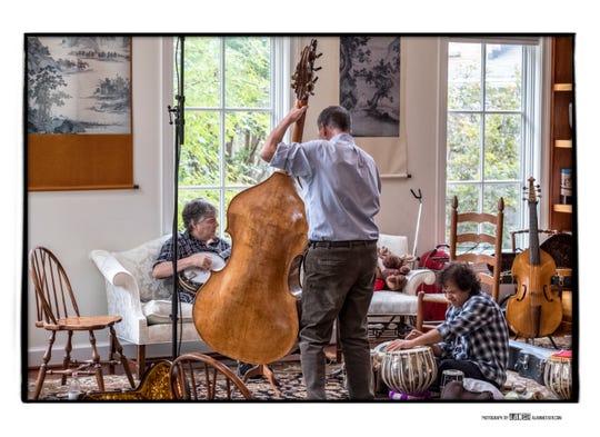 Bela Fleck, left, Edgar Meyer and Zakir Hussein rehearse together in October. The trio will perform Nov. 4 at Schermerhorn Symphony Center.