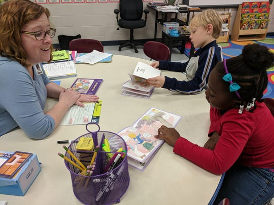 Students Hutch McKone and Aubrey Patton in Joanna Salce's first-grade class use the Literacy Footprints readers provided by the Dollar General Literacy Foundation grant.