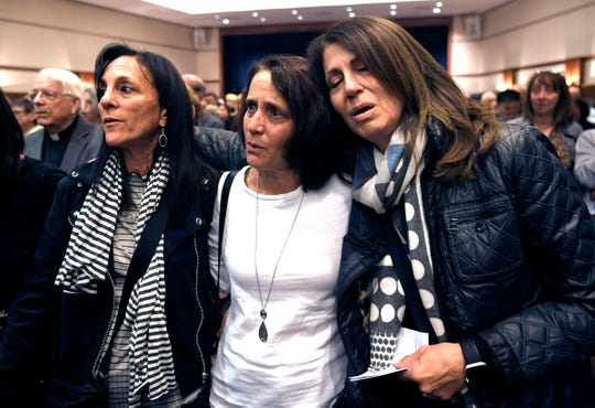 """Miriam Feldman, left, Andrea Stomel, and Shirley Feigenbaum sing """"God Bless America"""" during a memorial for the victims of the Tree of Life Synagogue in Pittsburgh at The Temple in Nashville on Monday, Oct. 29, 2018."""