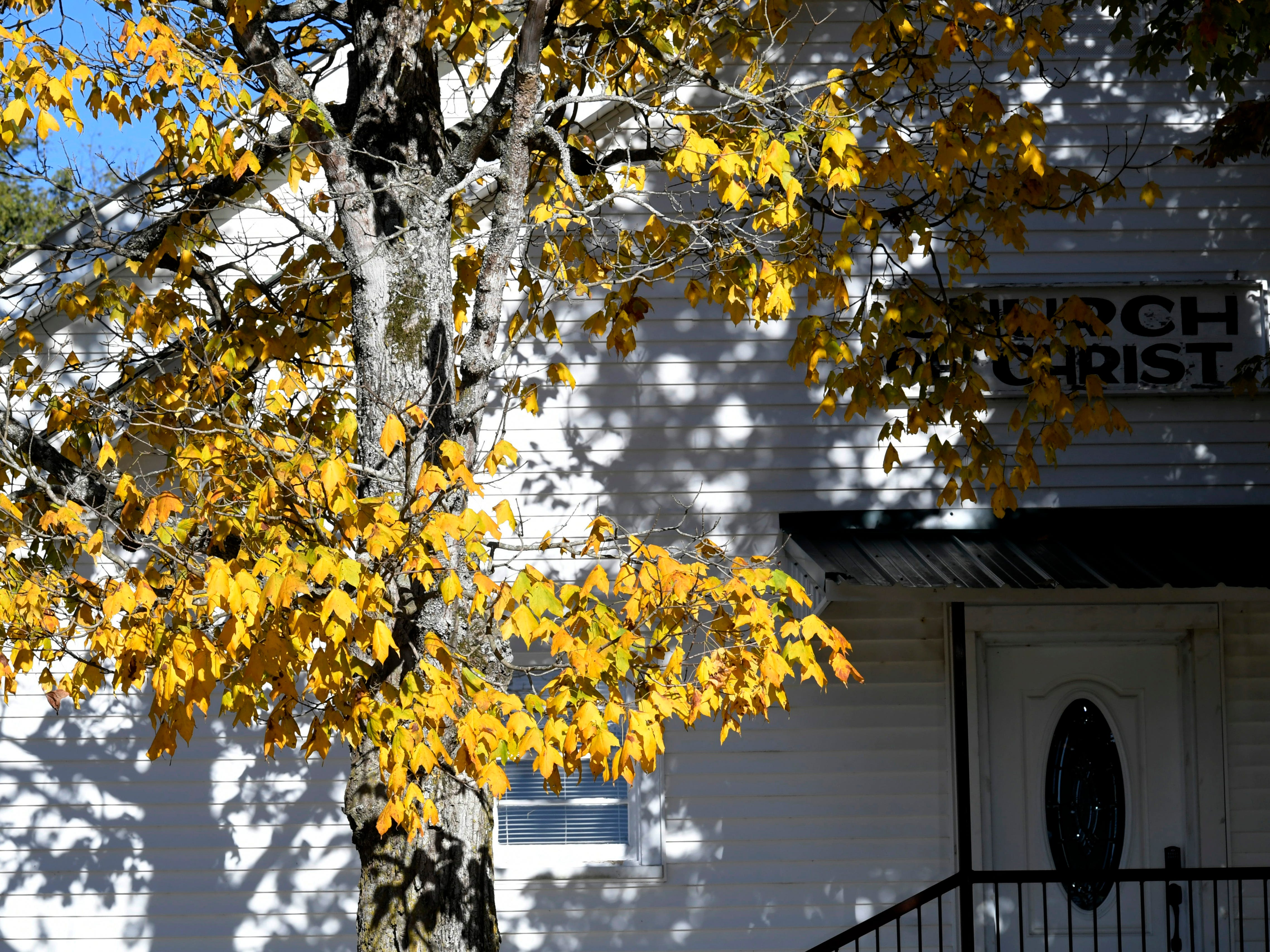 Leaves begin to change color at Burwood Church of Christ in Burwood, Tenn. on Tuesday, Oct 30, 2018.