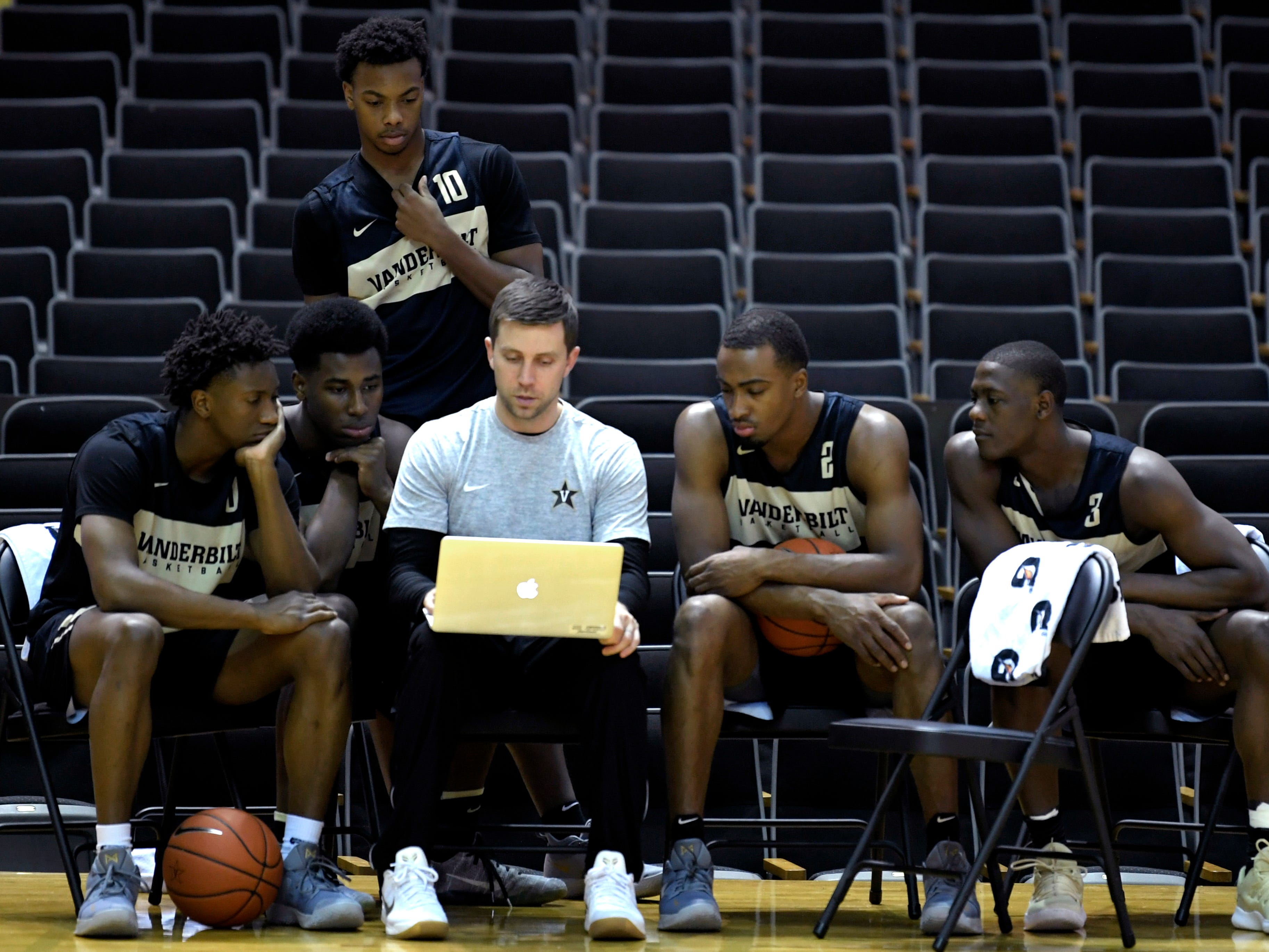 Vanderbilt basketball freshman Darius Garland,standing, watches film with assistant coach Jake Diebler and teammates during practice on Monday Oct. 22, 2018.