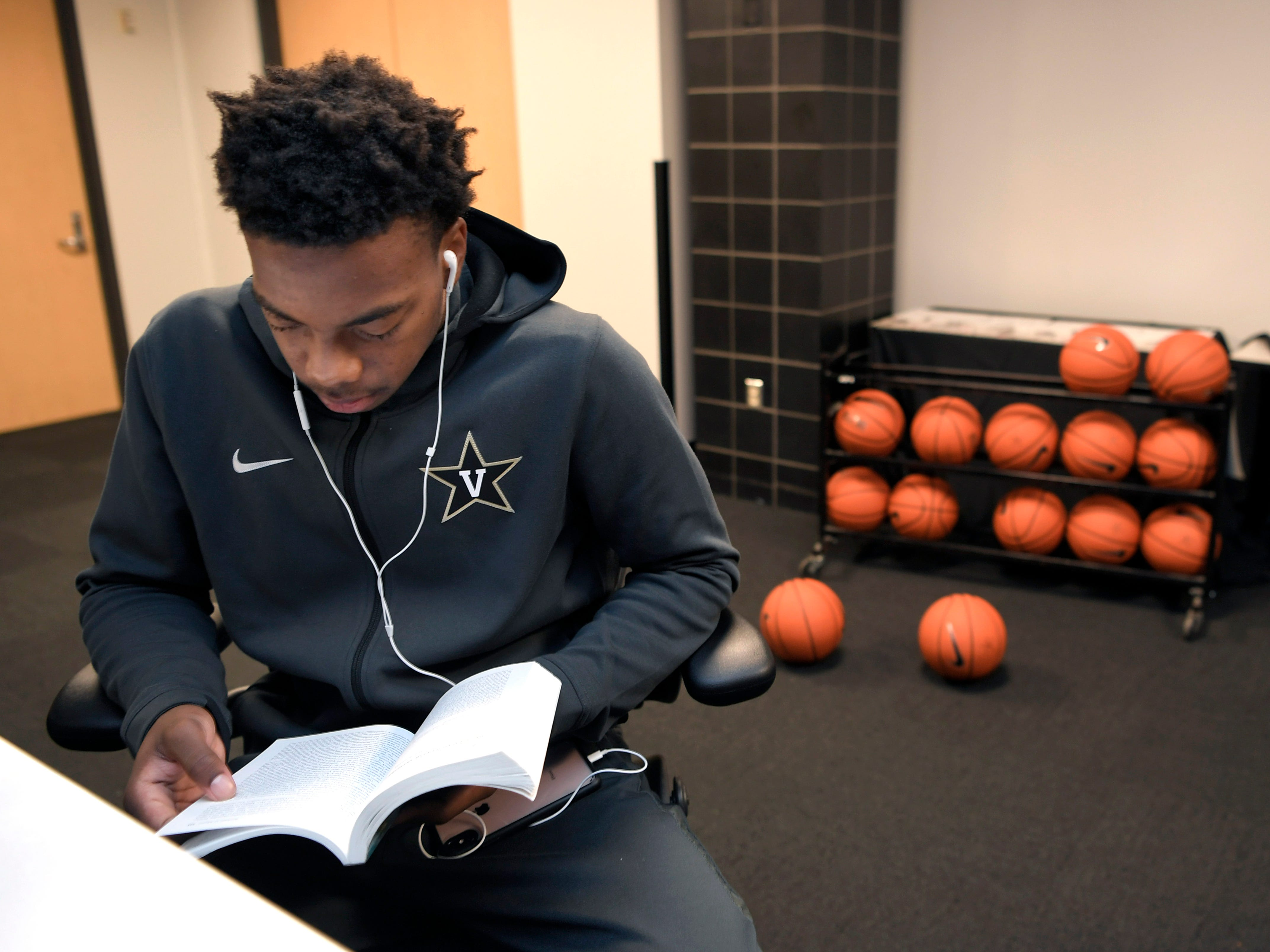 Vanderbilt basketball freshman Darius Garland  does homework in the players lounge before classes on Monday, Oct. 30, 2018.