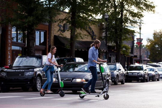 A pair of scooter riders cross Clearview Avenue at the intersection of North 11th Street in the Five Points neighborhood of East Nashville on Friday, Oct. 19, 2018.