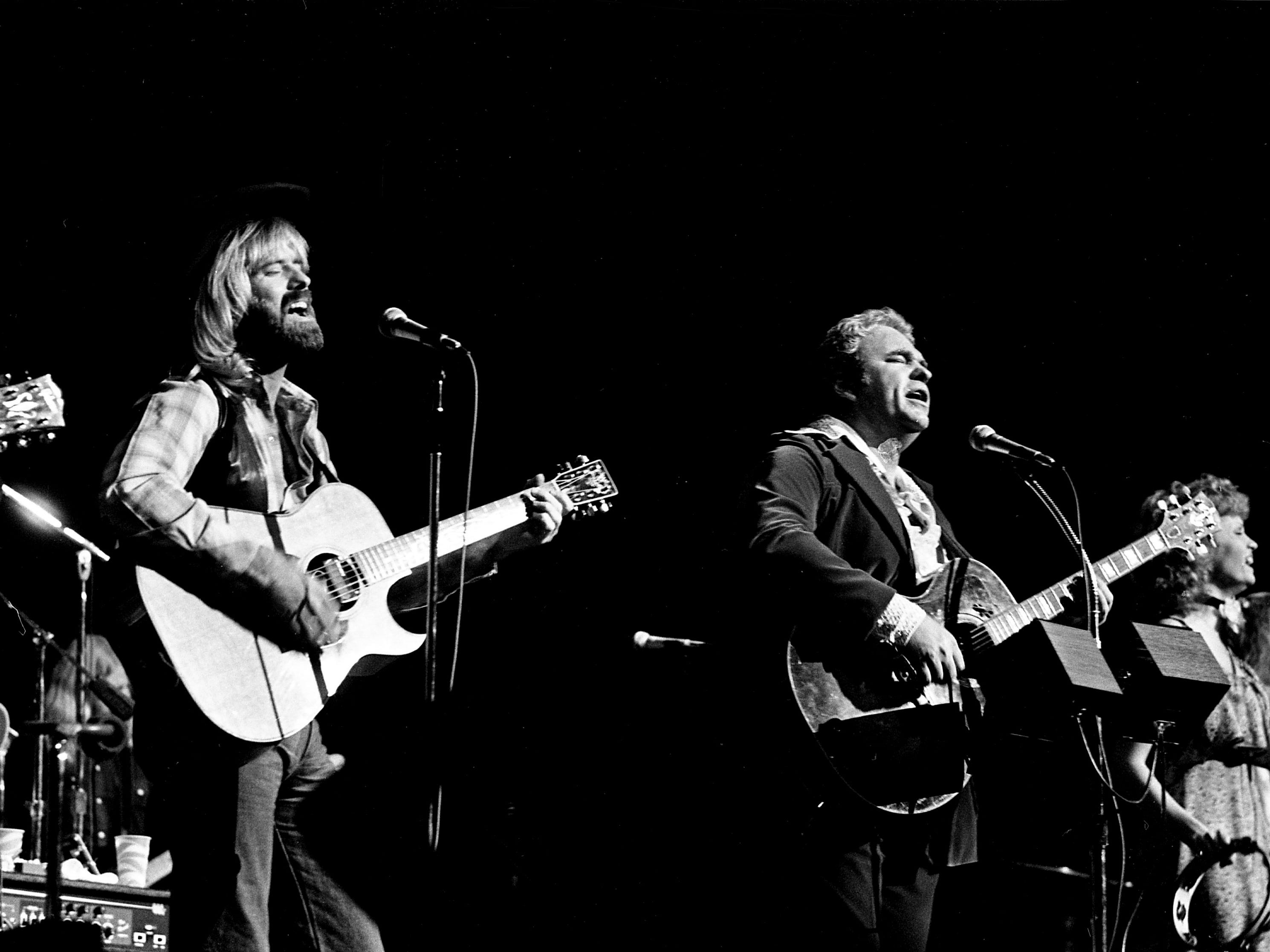 Special surprise guest Michael Martin Murphey, left, joins Hoyt Axton during Axton's Halloween concert at the Grand Ole Opry House on Oct. 31, 1978.
