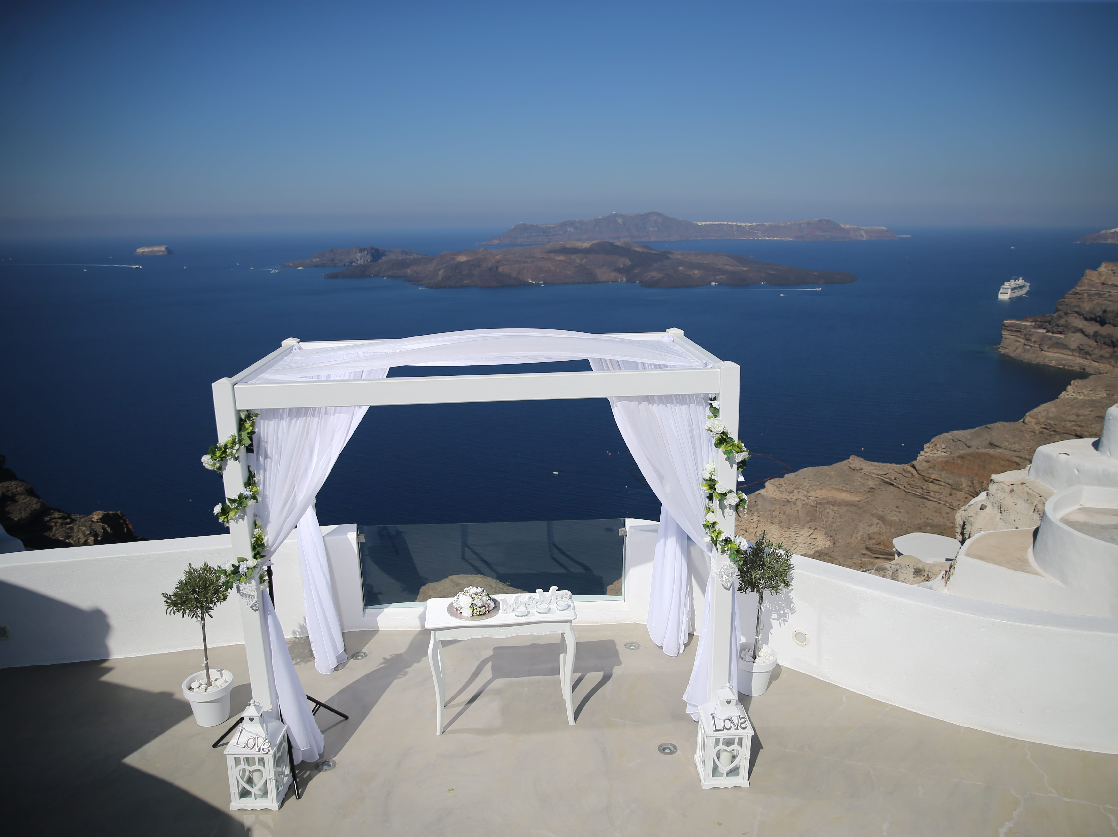 Naples travel advisor Pamela Price planned her own destination wedding on the Grecian island of Santorini in September. She married American Airlines pilot David Fisher. They had a couple of their best friends serve as witnesses.