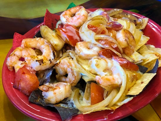 Mr. Tequila offers Shrimp Nachos with onions and tomato that covered with parmesano sauce and mozzarela cheese. $13.50 This year's National Nacho Day that is Nov. 6.