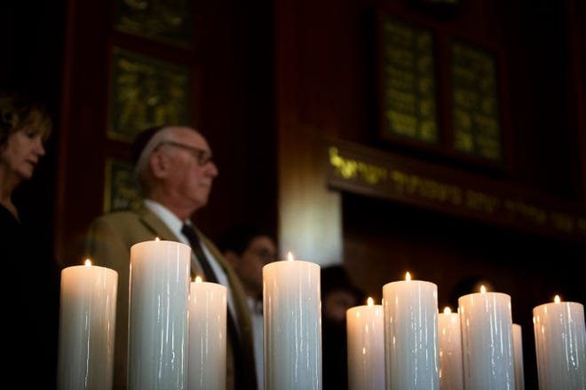 Eleven candles were lit in memory of the Pittsburgh shooting victims during a gathering of solidarity at Chabad Naples on Tuesday, Oct. 30, 2018.