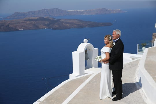 Naples travel adviser Pamela Price planned her own destination wedding on the Grecian island of Santorini in September. She married American Airlines pilot David Fisher. They had a couple of their best friends serve as witnesses.