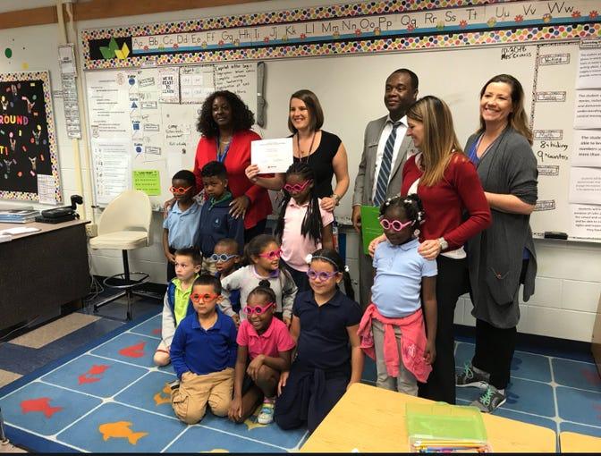 Lely Elementary School teacher Brittany Crouss receives her Teacher of Distinction award on Tuesday, Oct. 30, 2018.