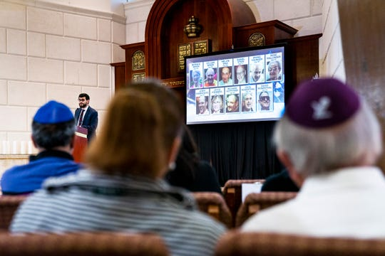 Rabbi Fishel Zaklos reads the names of the victims, shown on screen, during a gathering of solidarity at Chabad Naples on Tuesday, Oct. 30, 2018. The gathering was in solidarity with the Pittsburgh Jewish Community after eleven congregants were shot and killed at the Tree of Life Synagogue in Pittsburgh, PA on Saturday.