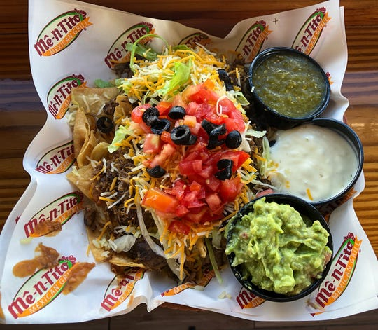 Me-n-Tito's Chip Mountain Nachos with Shredded Beef in Fort Myers. It includes choices of five toppings, extra for guacamole, for $7.75 This year's National Nacho Day that is Nov. 6.