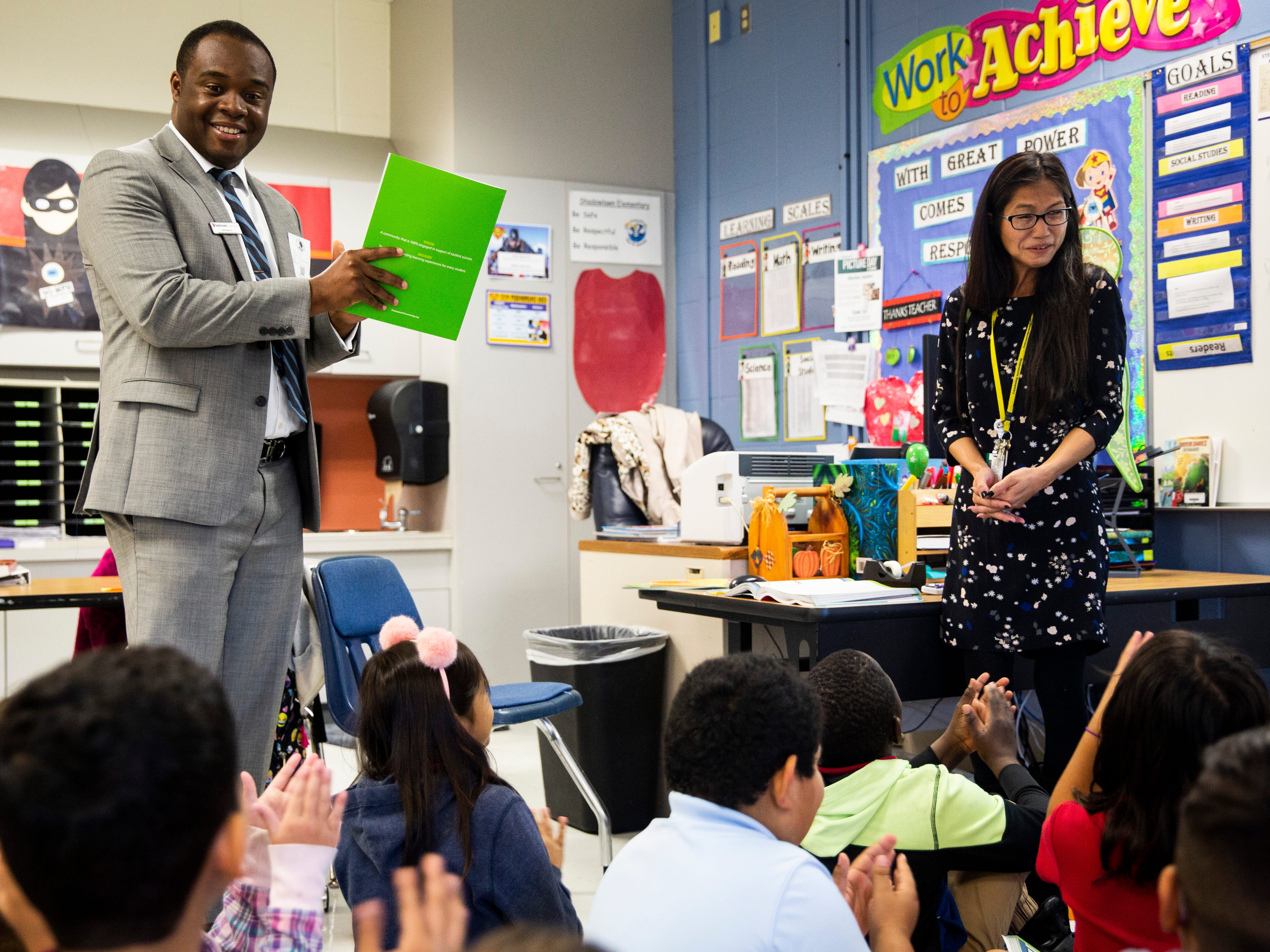 Herby Berson presents a Teachers of Distinction certificate from Champions For Learning to Phuong Gano on Tuesday, Oct. 30, 2018, at Shadowlawn Elementary School in East Naples.