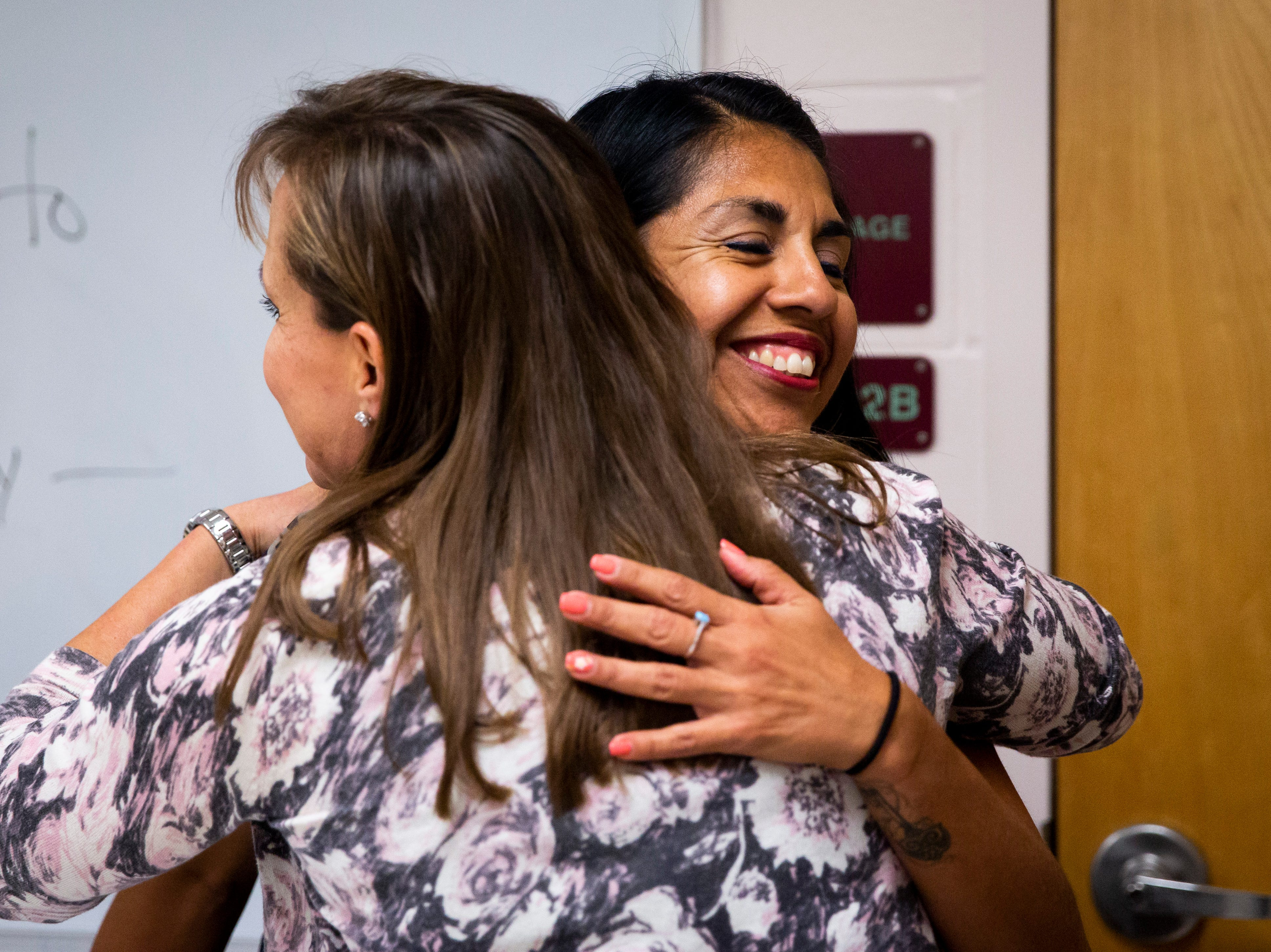 Principal Lynda Walcott hugs Sandy Mendoza after she was presented with a Teachers of Distinction certificate from Champions For Learning on Tuesday, Oct. 30, 2018, at Calusa Park Elementary School in East Naples.
