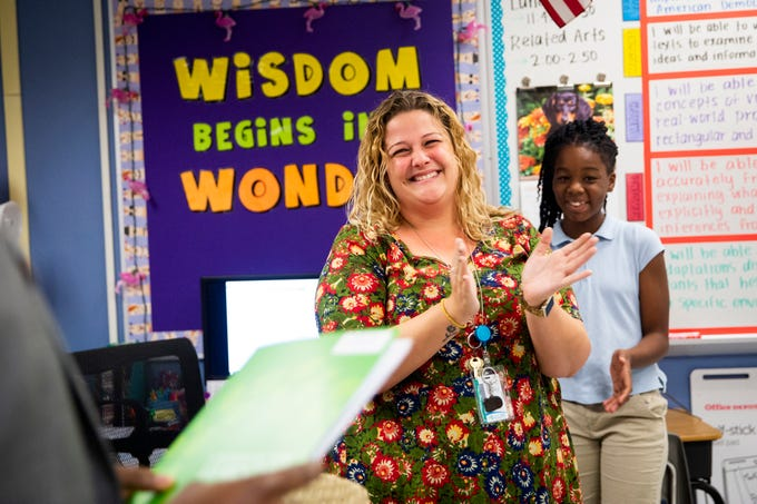 Herby Berson presents Christine Brady with a Teachers of Distinction certificate from Champions For Learning on Tuesday, Oct. 30, 2018, at Avalon Elementary School in East Naples.