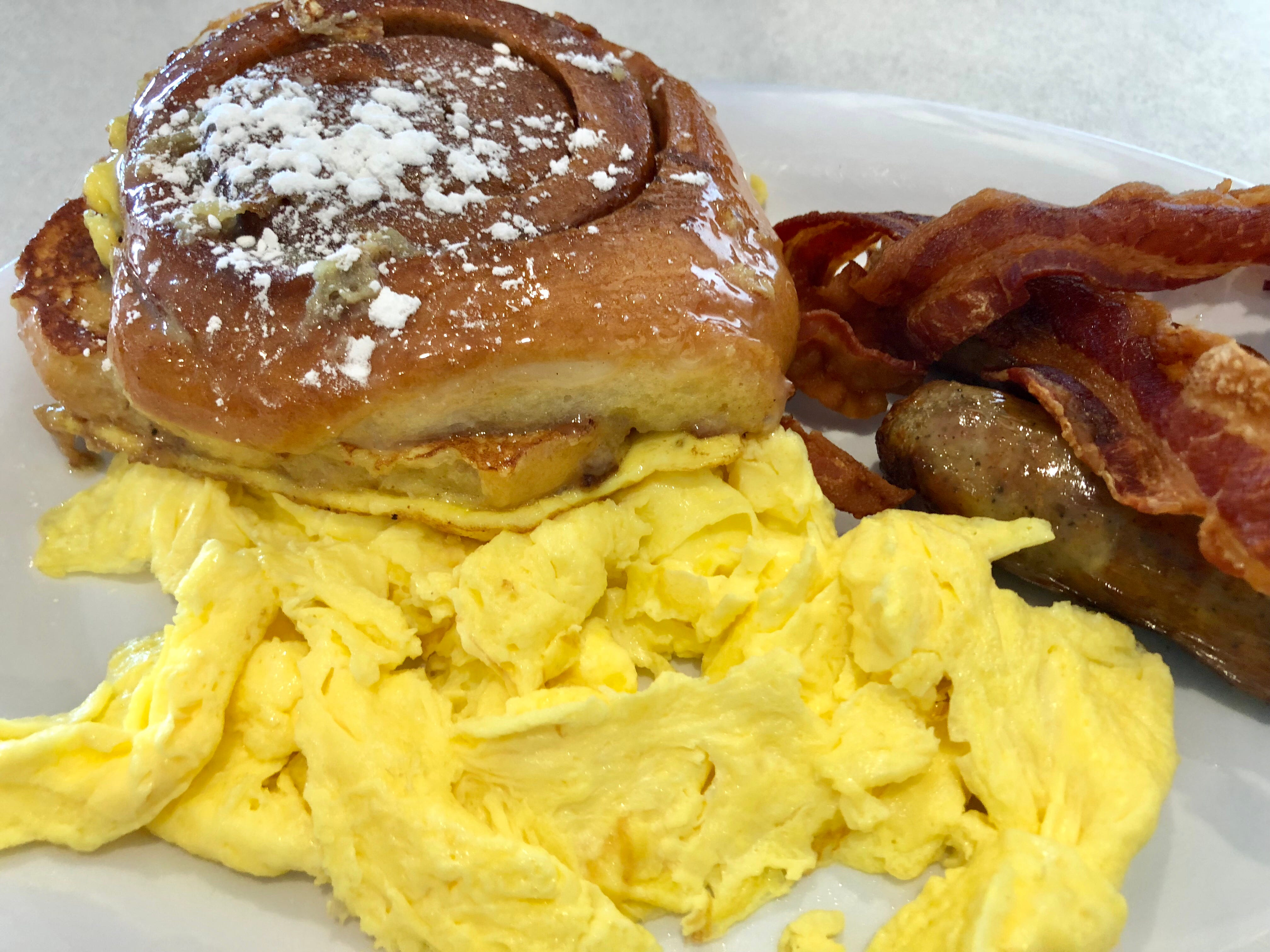 The LuLu Belle includes scrambled eggs, bacon, sausage and cinnamon roll French toast.