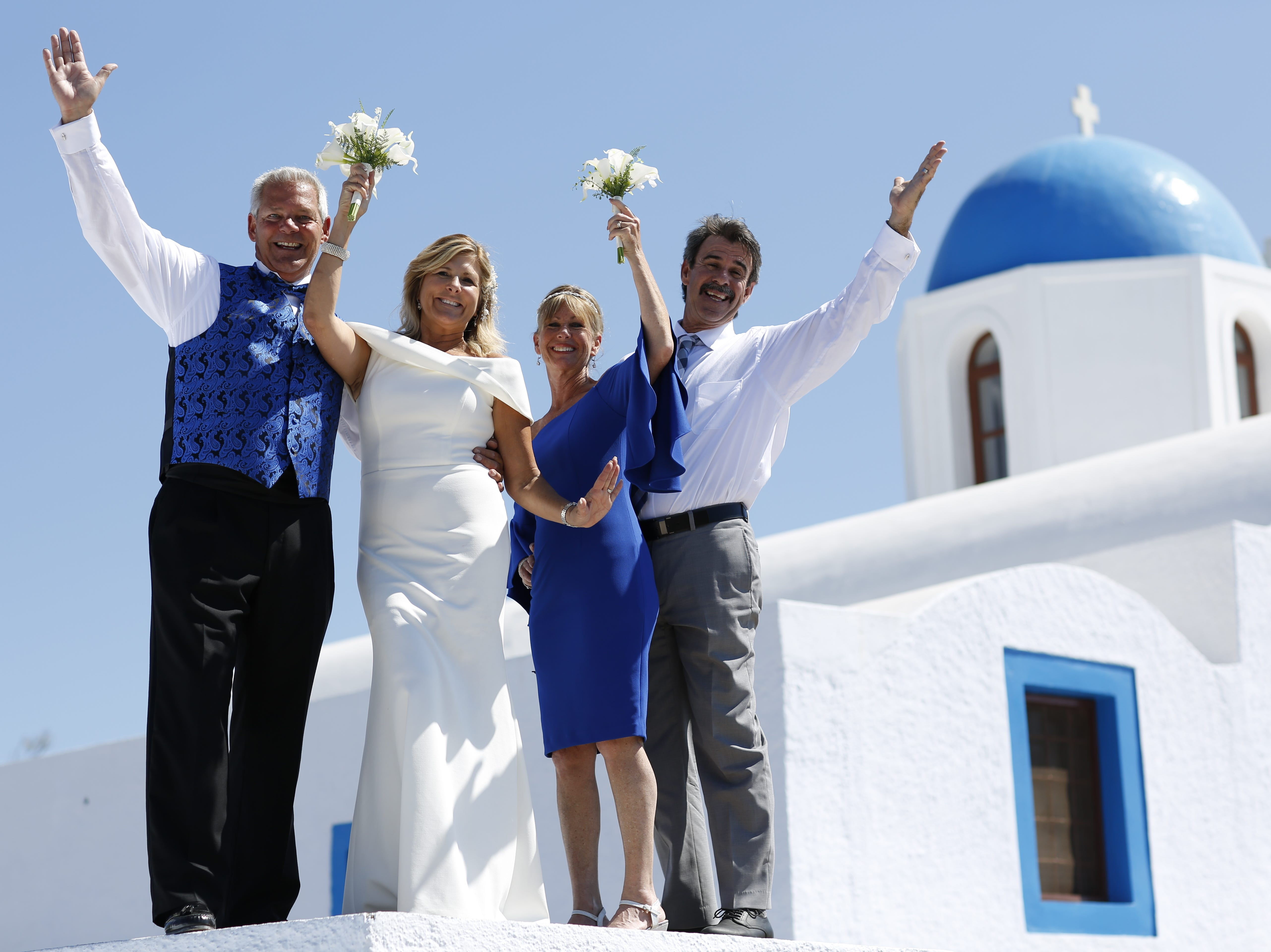 Naples travel advisor Pamela Price planned her own destination wedding on the Grecian island of Santorini in September. She married American Airlines pilot David Fisher, left. They had a couple of their best friends serve as witnesses.